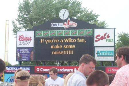 Scoreboard at Wilco concert that reads id=&quotIf you're a Wilco fan, make some noise!id=&quot