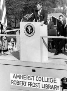 Kennedy speaking at podium