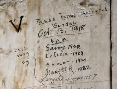 People have ventured up to the tower (now heavily alarmed) to sign their names and mark various dates, including Oct. 13, 1948, which, incidentally, was not a Sunday, and, as far as we can tell, was not the date of any major world event.