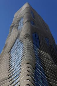 September 8, 2009<br><b>The Aqua tower in Chicago</b><br>Aqua, the spectacular new Chicago skyscraper with the sensuous, undulating balconies, is the pearl of the long-running, now-ending Chicago building boom, a design that is as fresh conceptually as it is visually. A skyscraper typically consists of repetitive, right-angled parts, a money-saving device that frequently produces aesthetic monotony. But in this defiantly non-Euclidian high-rise, almost nothing seems to repeat. Its white, wafer-thin balconies bulge outward, each slightly different from the other. They race around corners and shoot upward in fantastic, voluptuous stacks. This is a new vision of verticality, and it makes Aqua one of Chicago's boldest -- and best -- skyscrapers in years.<br><i>Chicago Tribune photo by Michael Tercha</i>