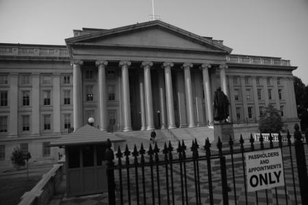 September 10, 2006<br><b>The Treasury Department Building in Washington, D.C.</b><br>They are ruining Washington, ruining it in the name of saving it. Five years after the Sept. 11 terrorist attacks, this once-lovely city of broad diagonal avenues and open vistas is becoming an ever more-militarized zone that illustrates the profound tensions convulsing government buildings throughout the nation. Disturbing long-established patterns of everyday life in cities big and small, that tension is between security and openness, the imperative to fortify and the desire to beautify. And in this struggle between armor and aesthetics, armor is invariably emerging the victor, marring public buildings and public spaces that symbolize the ideals of democracy and help hold together a diverse, often-fractious society.<br><i>Chicago Tribune photo by E. Jason Wambsgans</i>