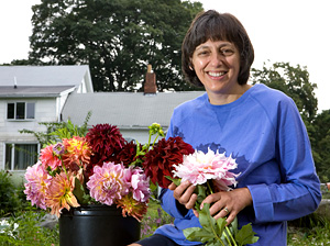 Marie Fowler holds some of her freshly-cut flowers