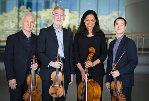 Juilliard Quartet, standing and holding their instruments