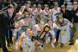 Women's basketball team posing with their DIII National title tropy