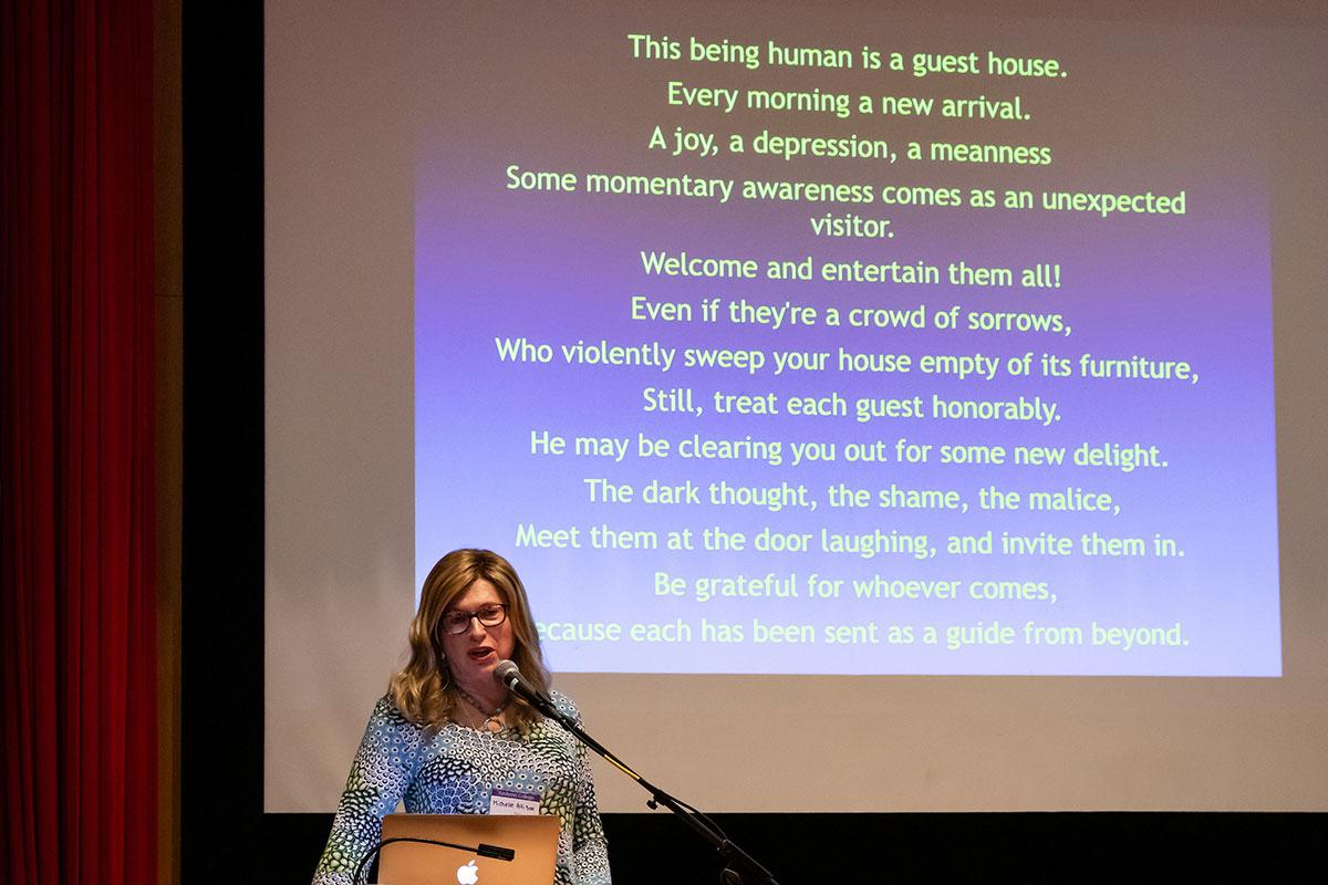Alumni Michelle Allison giving a talk on campus