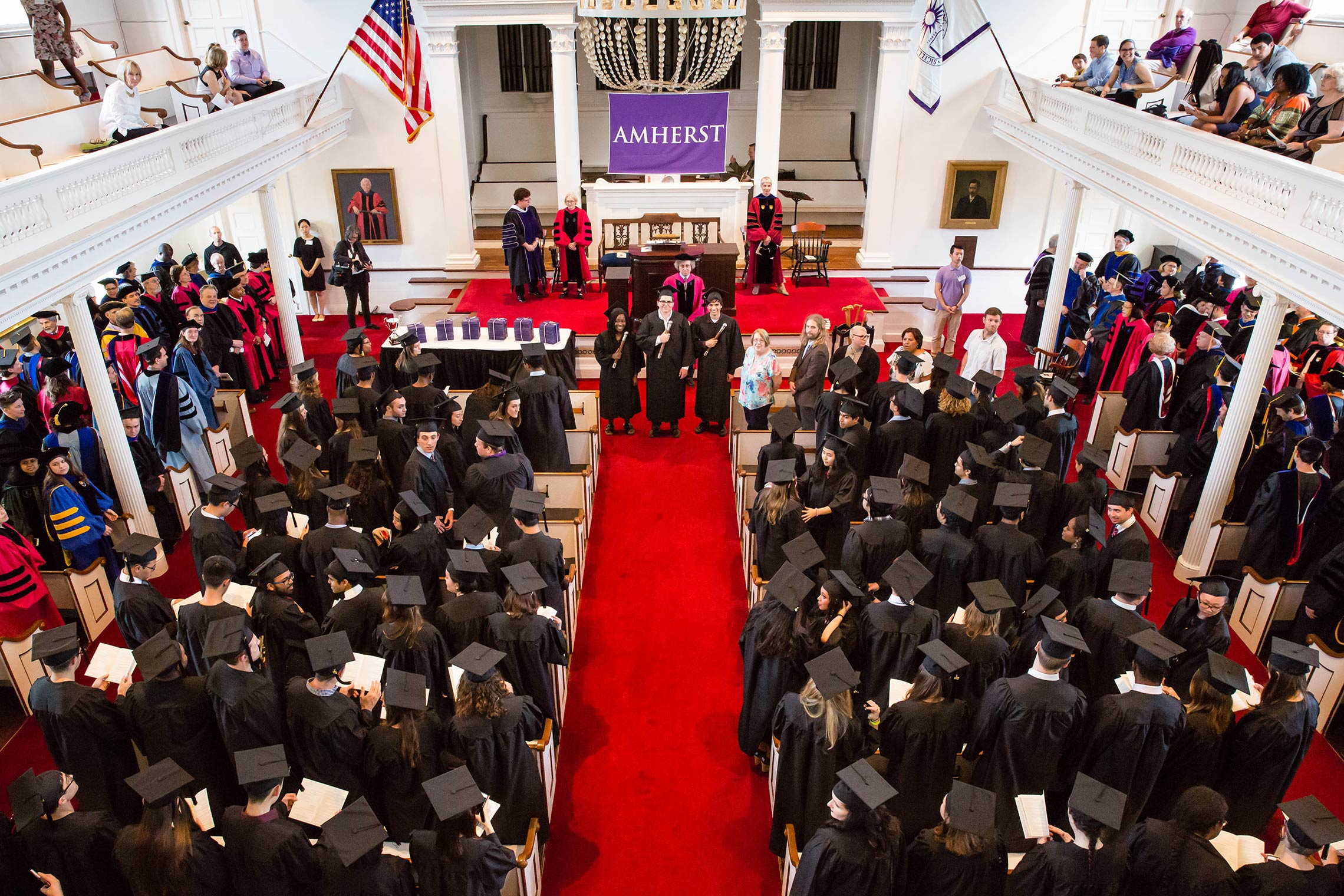 The crowd gather in Johnson Chapel, after the procession, for Senior Assembly