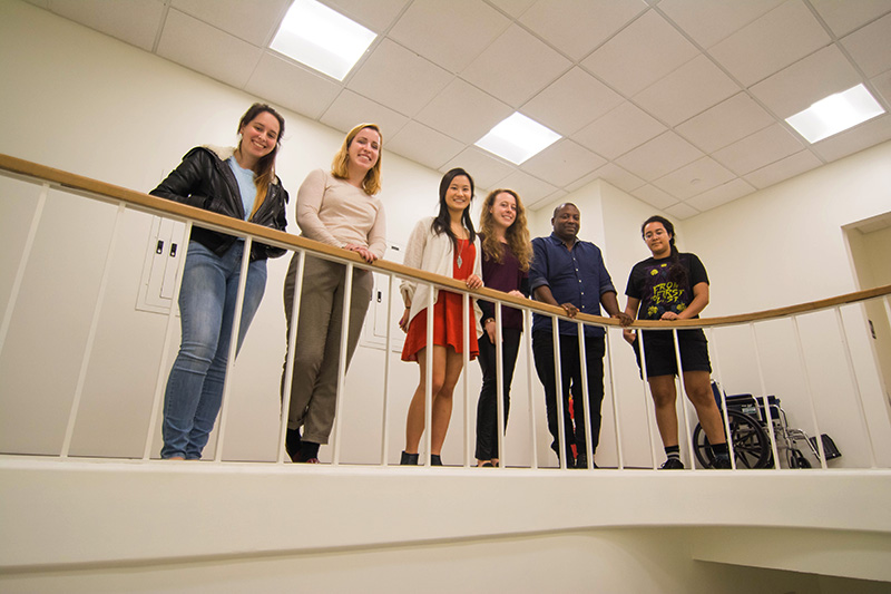 Amherst students with artist Rico Gatson in the Mead hallway where the mural will soon take shape. Photo by Matthew Chow '18.
