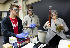 Professor Patricia OHara performing a chemistry experiment with two students