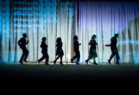 Silouette of actors in a show
