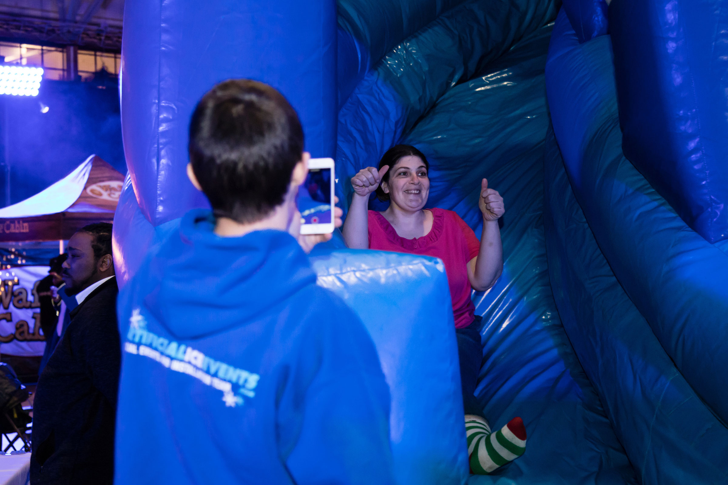 A woman rides the inflatable slide
