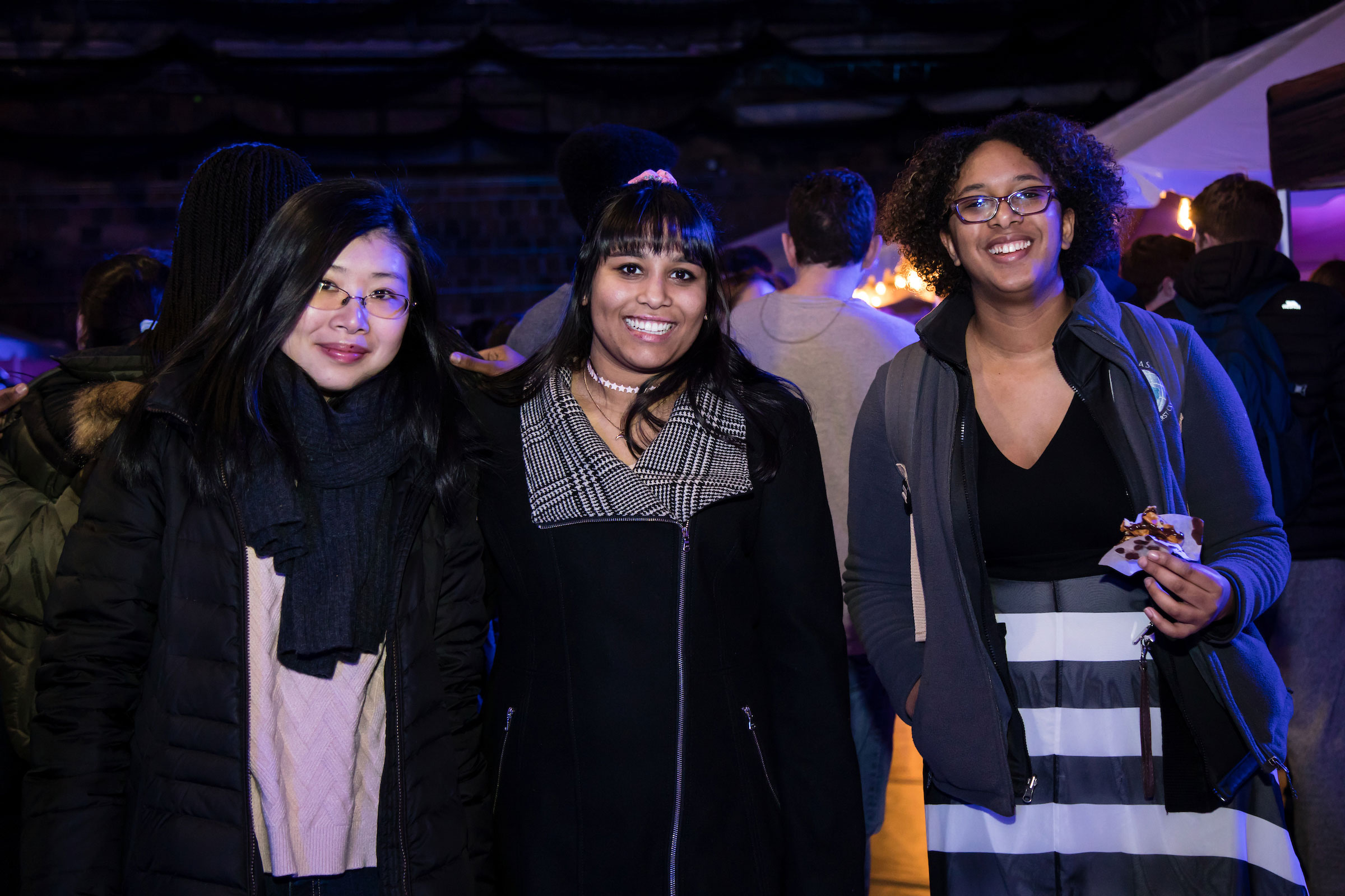 Three women pose for the camera at Winter Fest