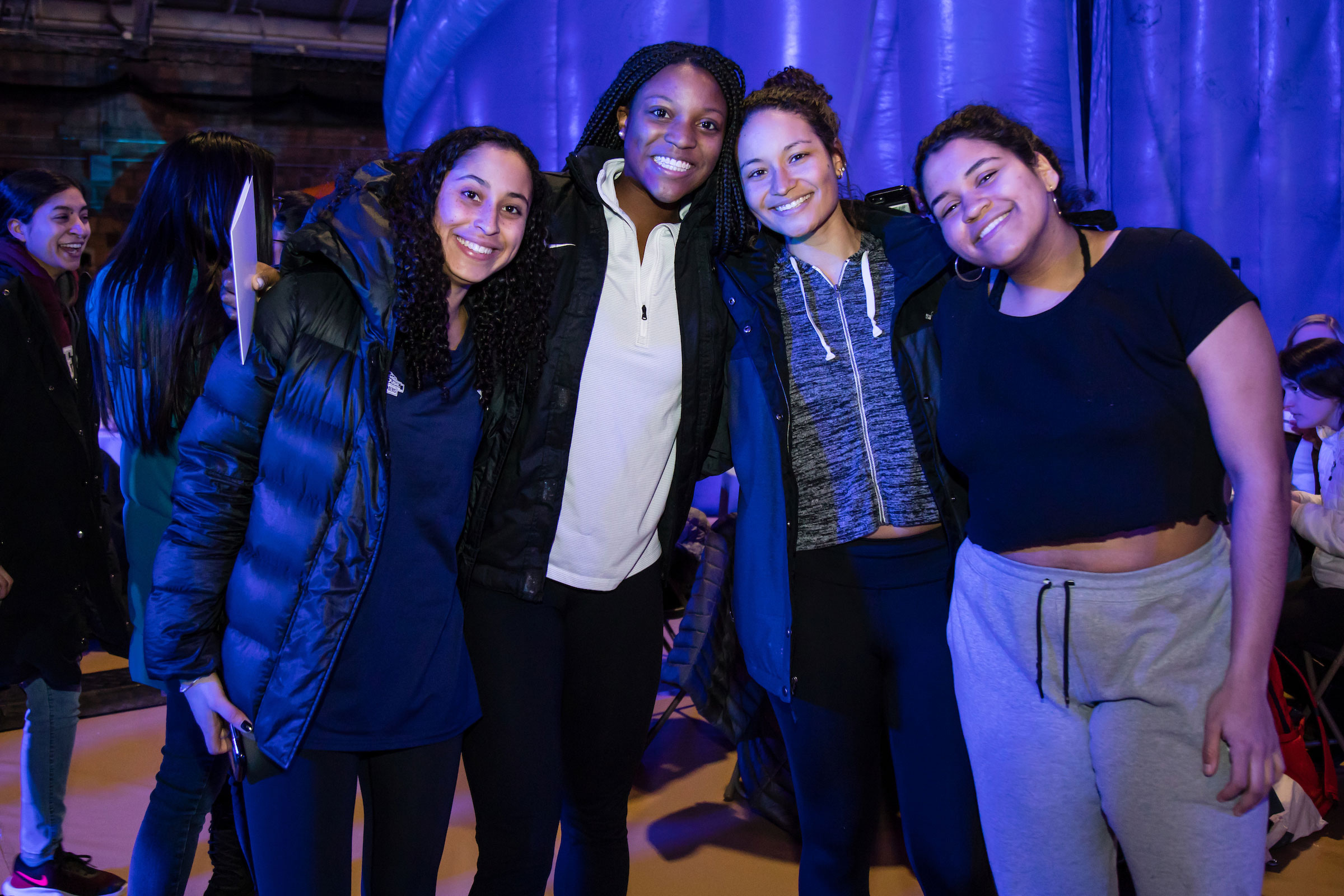 Four smiling women pose for the camera at Winter Fest
