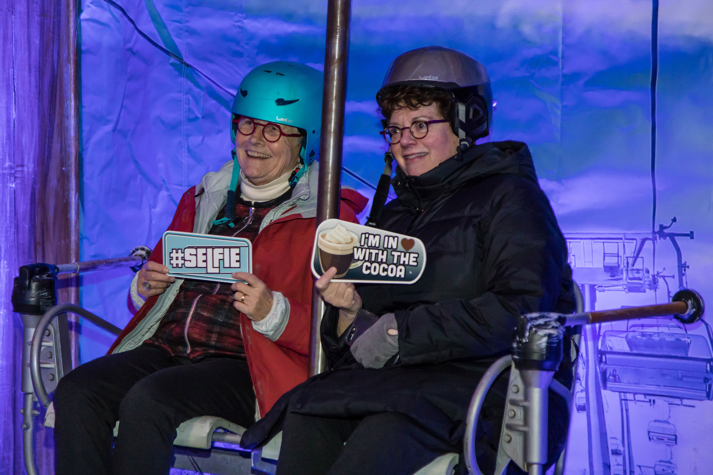 President Biddy Martin poses on the ski lift for a photo