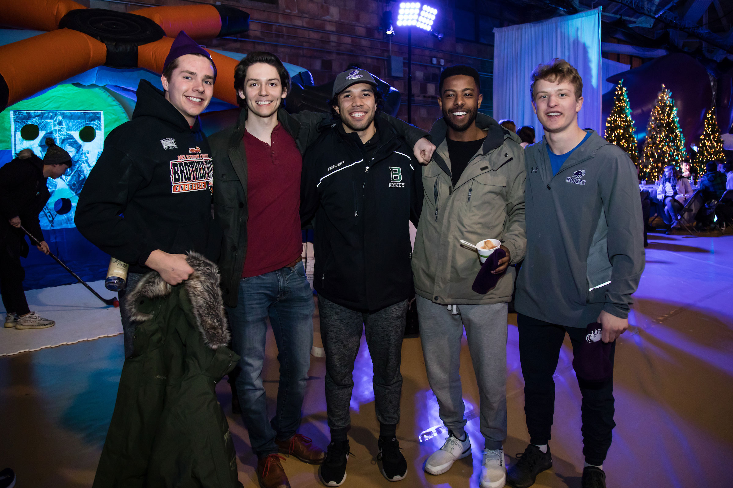 Five men smile for the camera at Winter Fest