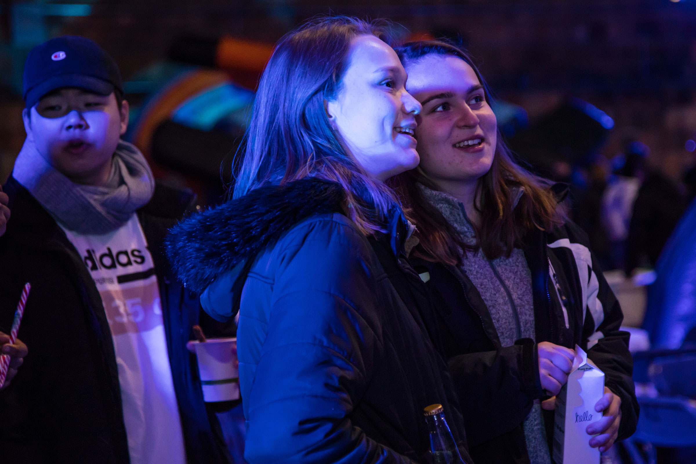Two friends enjoying watching the activities at Winter Fest