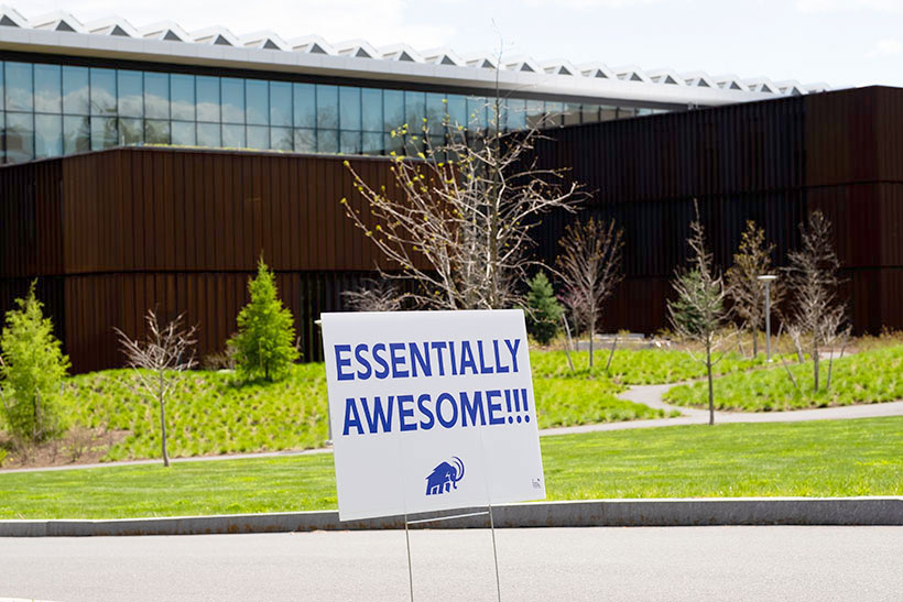 A sign in front of the Science Center that reads essential awesome