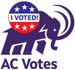 The mammoth with a button saying I Voted and underneath saying AC Votes