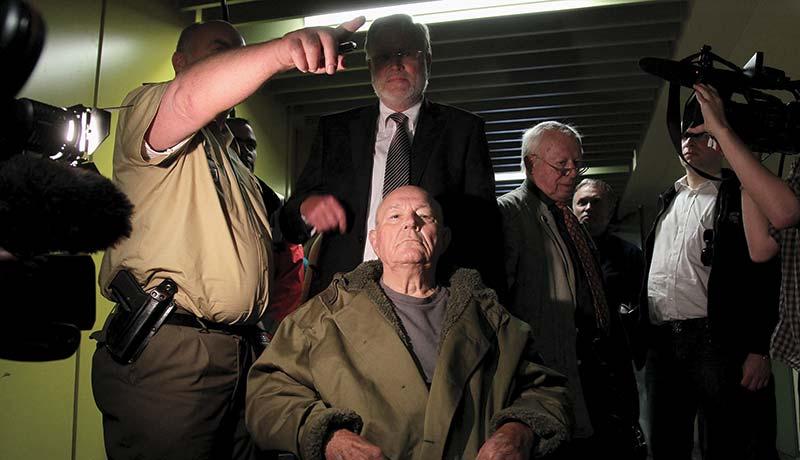 John Demjanjuk leaving court