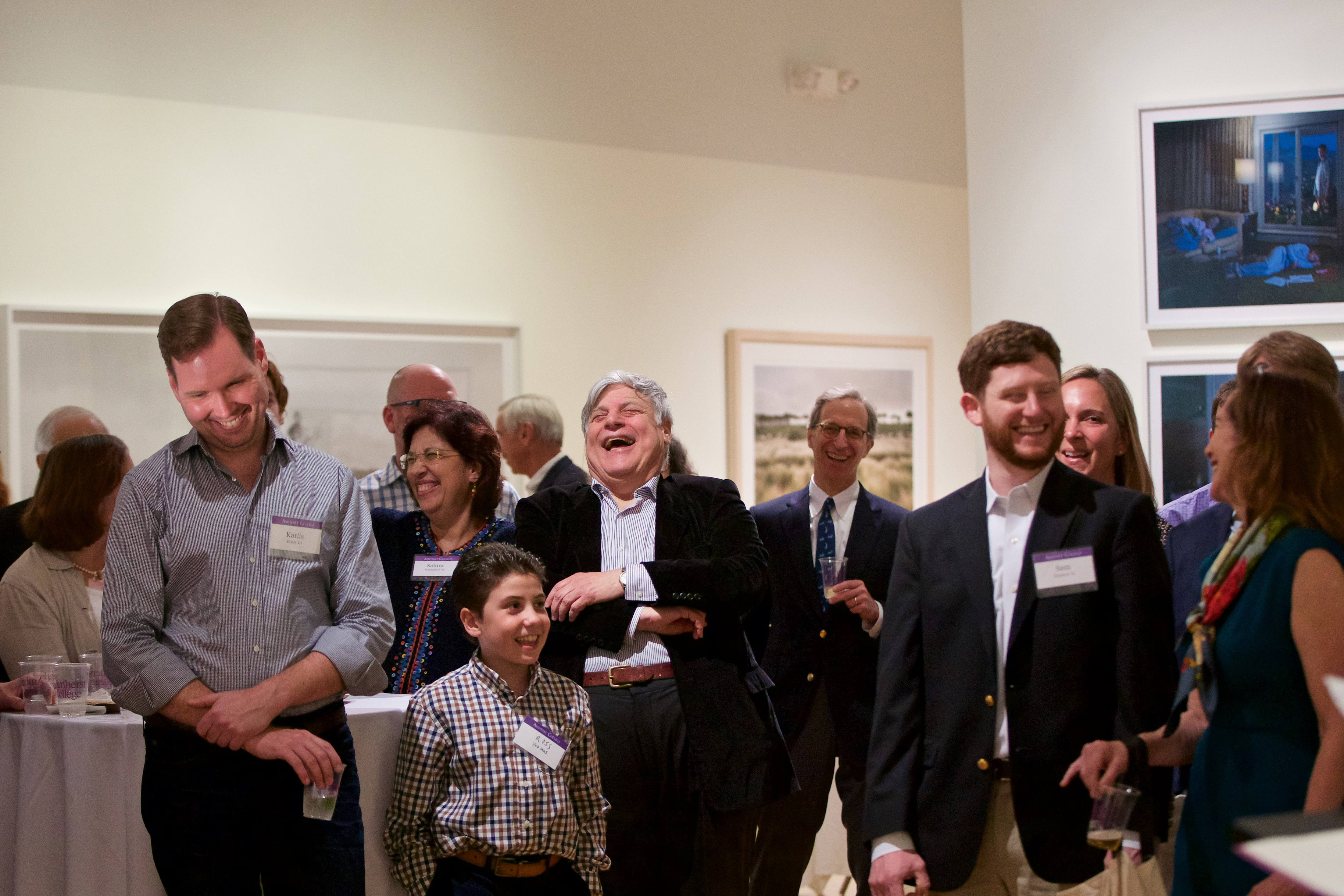 Rabinowitz and guests laughing