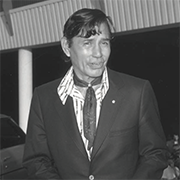 A black and white photo of a man in a suit