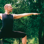 A man posing in a yoga position outdoors