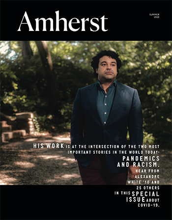 The cover of the Amherst magazine with a man in a suit on the cover