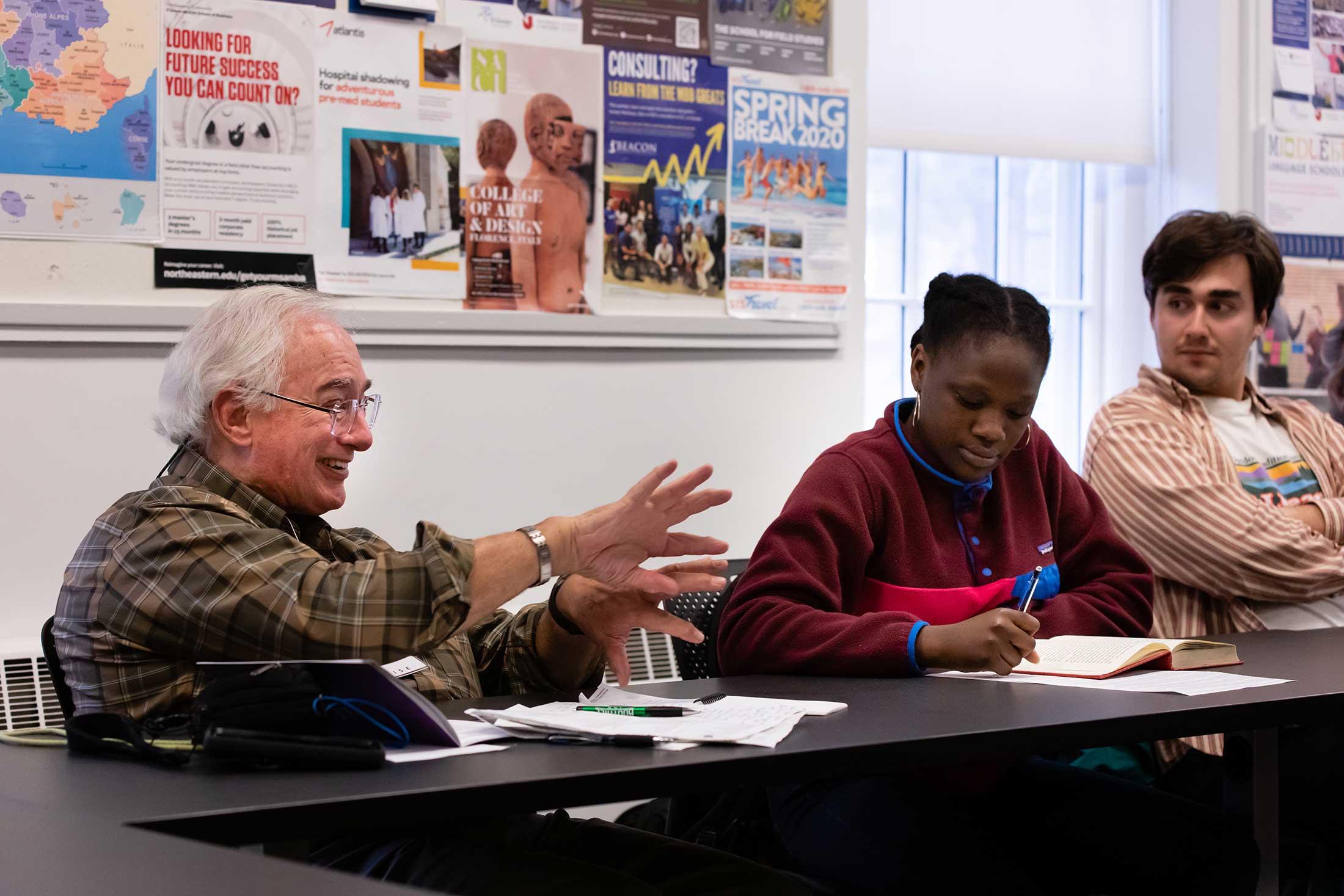 An alumni participating in Professor Sanborn's literature class