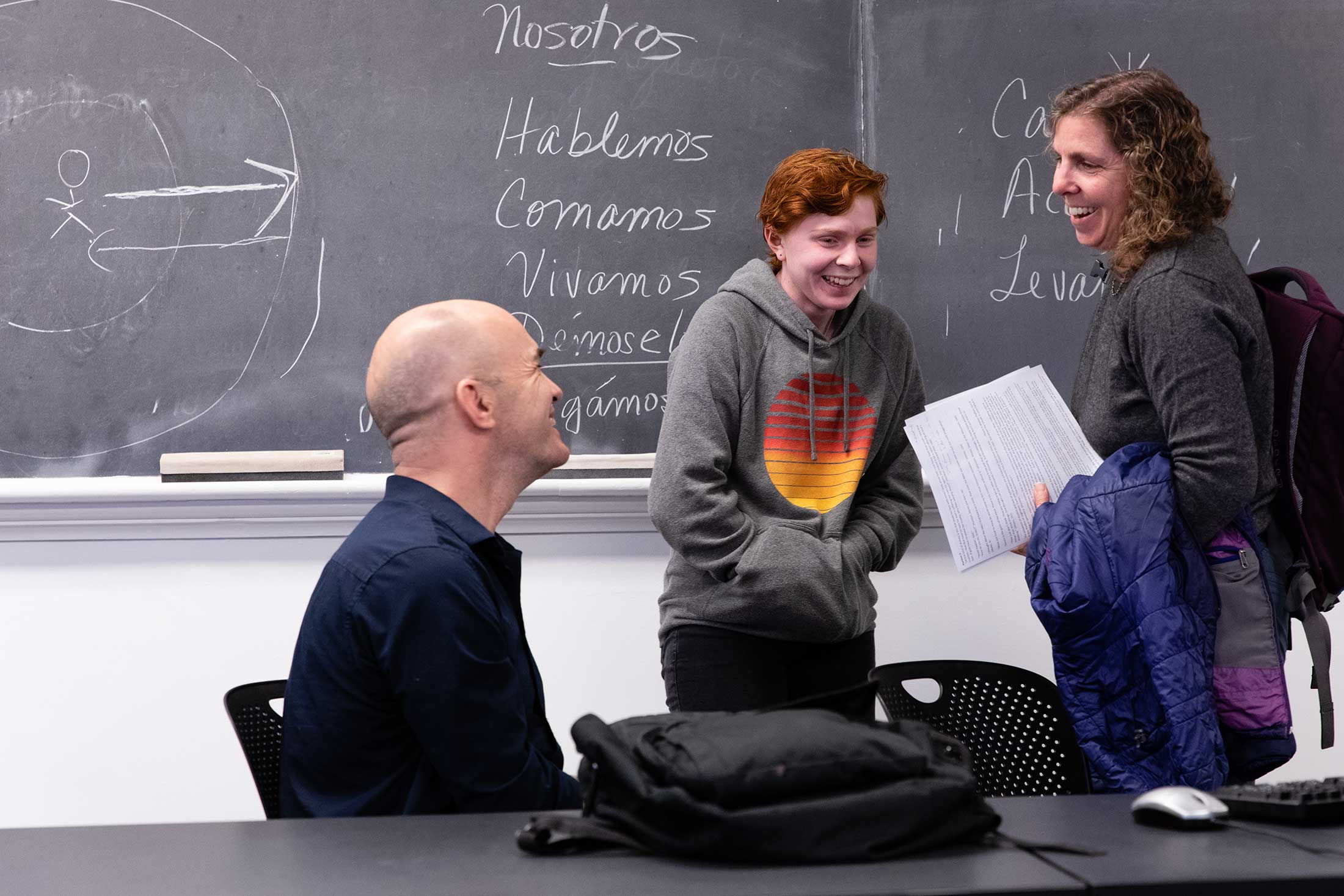 Professor Sanborn speaking with attendees of his literature class during homecoming