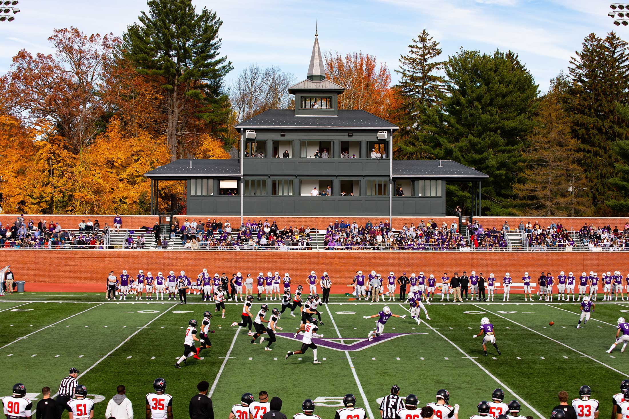 Amherst College's football team in action