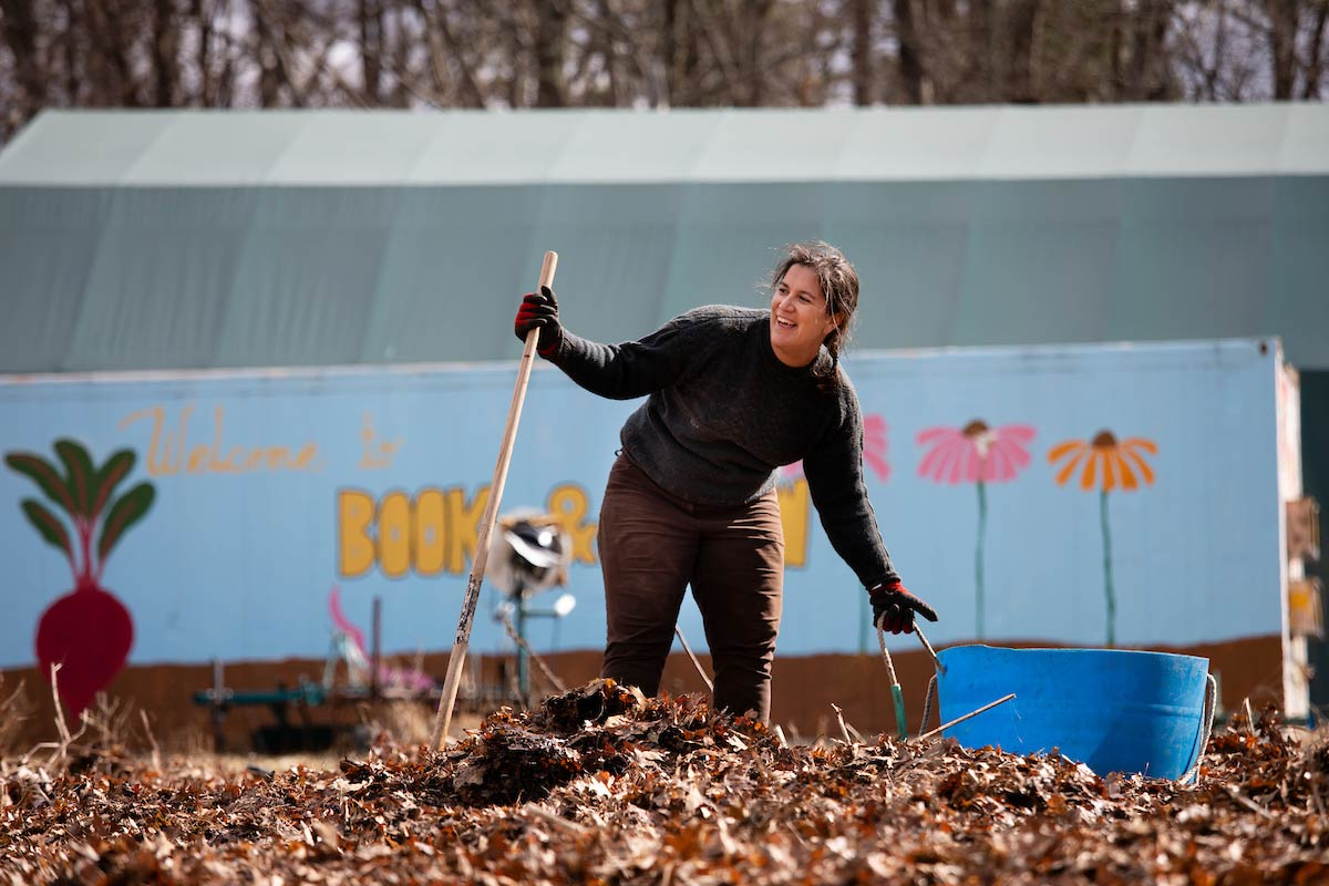 Maida Ives, manager of farm education and operations at the Book & Plow Farm, standing in front of a shipping container