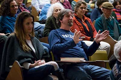 Audience members listening to Lisa Brooks' lecture at Greenfield Community College