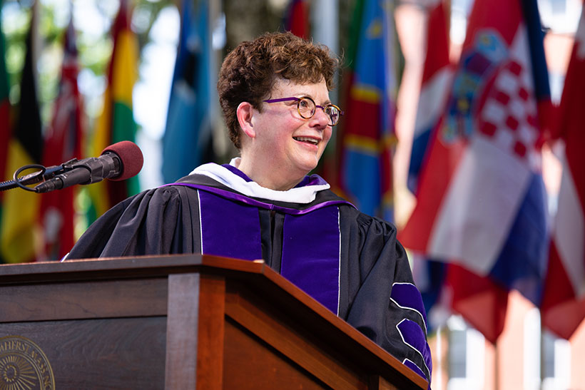 President Biddy Martin speaking at the podium during commencement