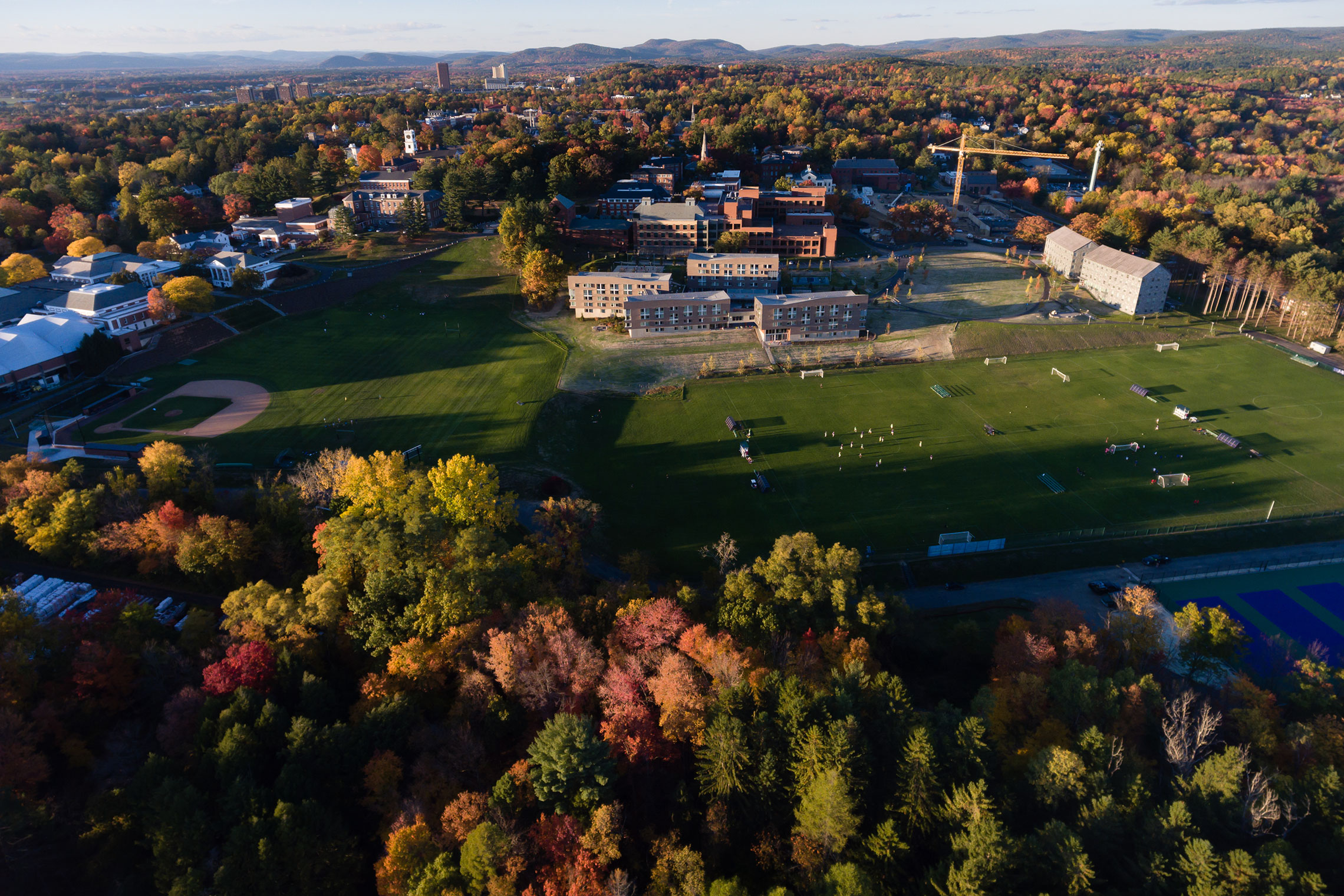 Aerial view of Amherst College campus in autumn.