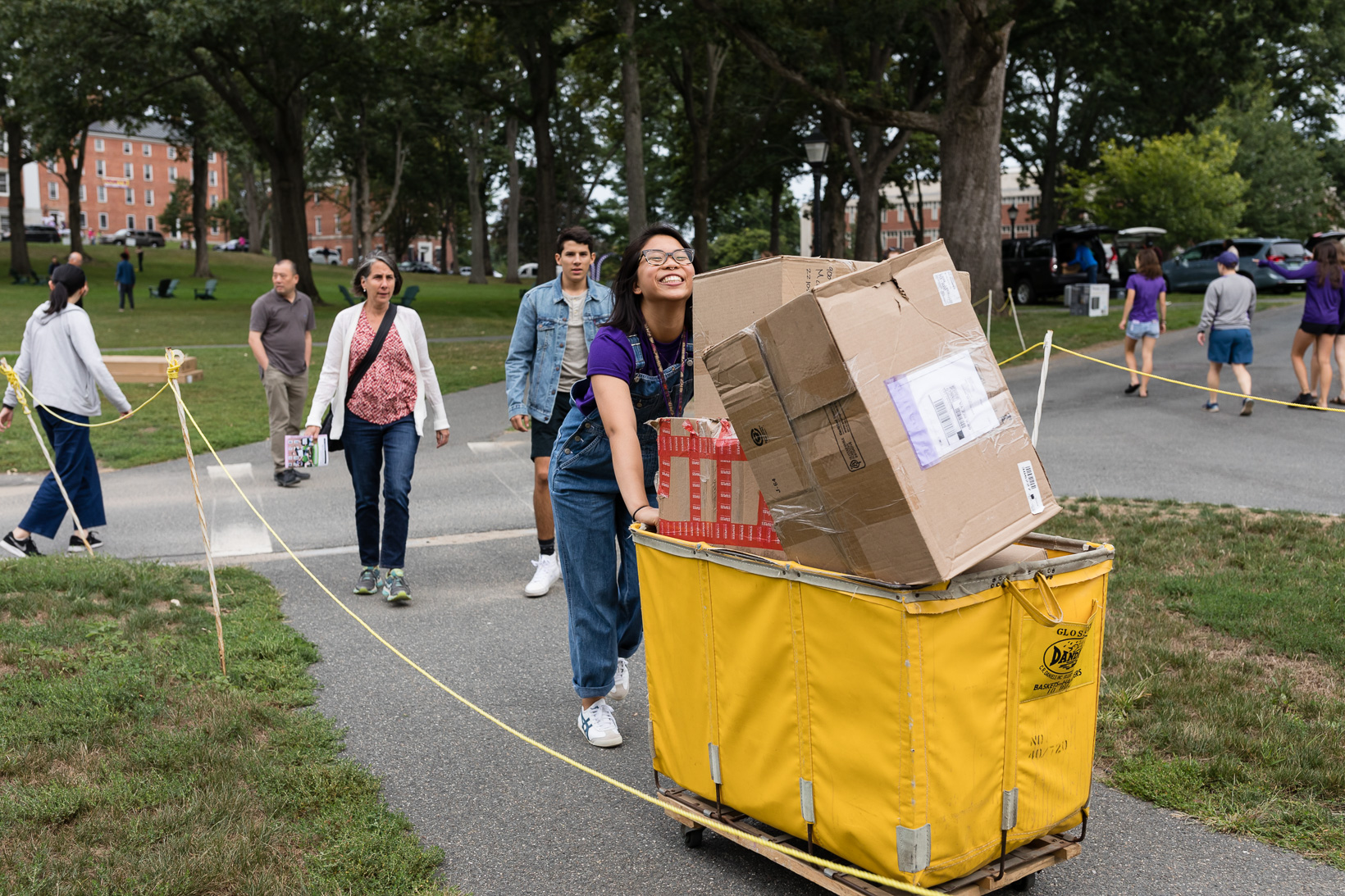 Students pushing carts full of belongings on move-in day.
