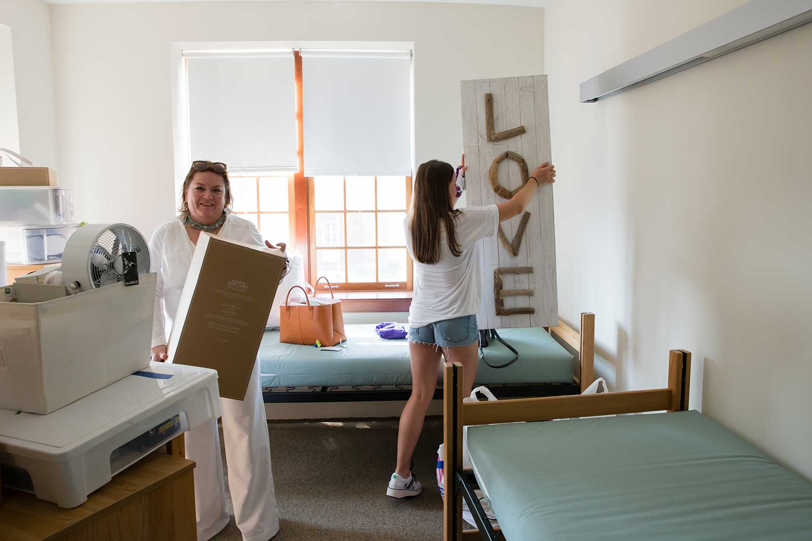 Madeline Clinton '22, shown here with her mother, Tracy, moving into her residence hall.
