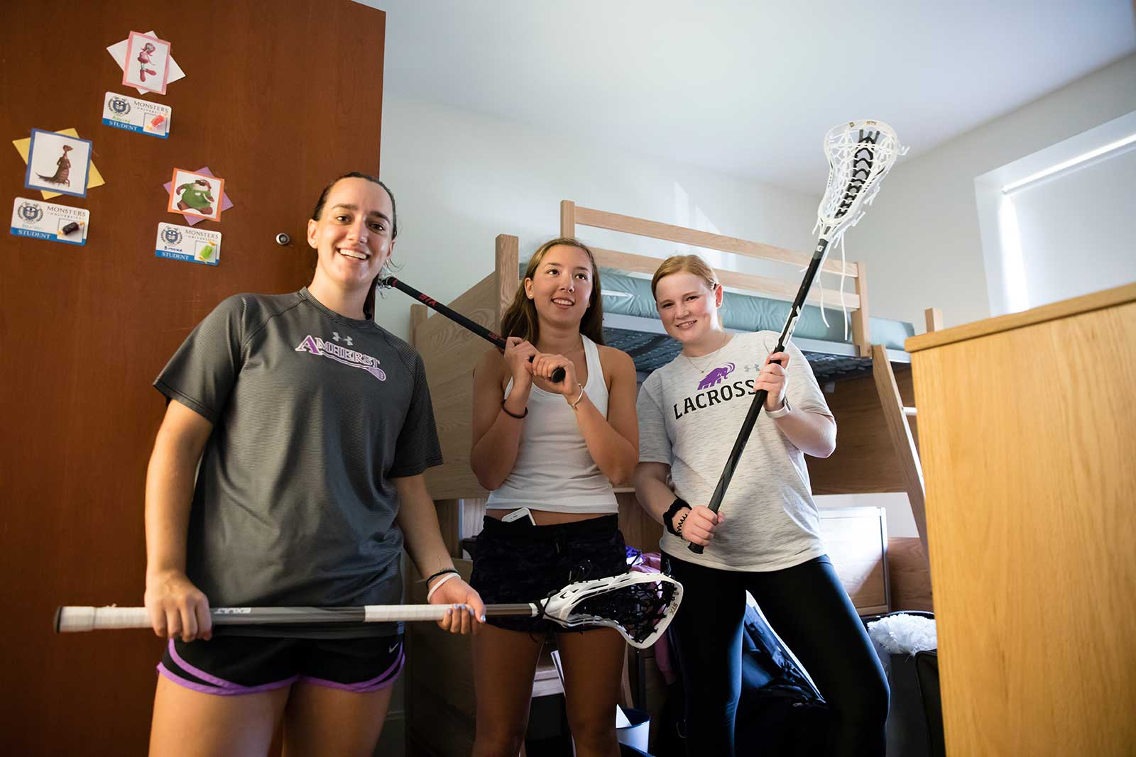 Kathleen Krieg '20 and Kaitlyn Haase '19, captains of women's lacrosse, helping classmate Ashly Tucker '22 move into James Hall.