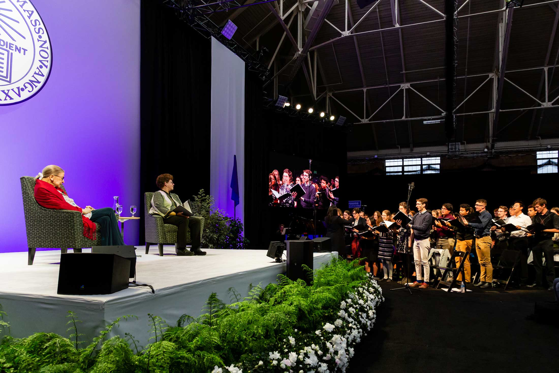 Justice Ginsburg and President Biddy Martin listening to the Choral Society performing