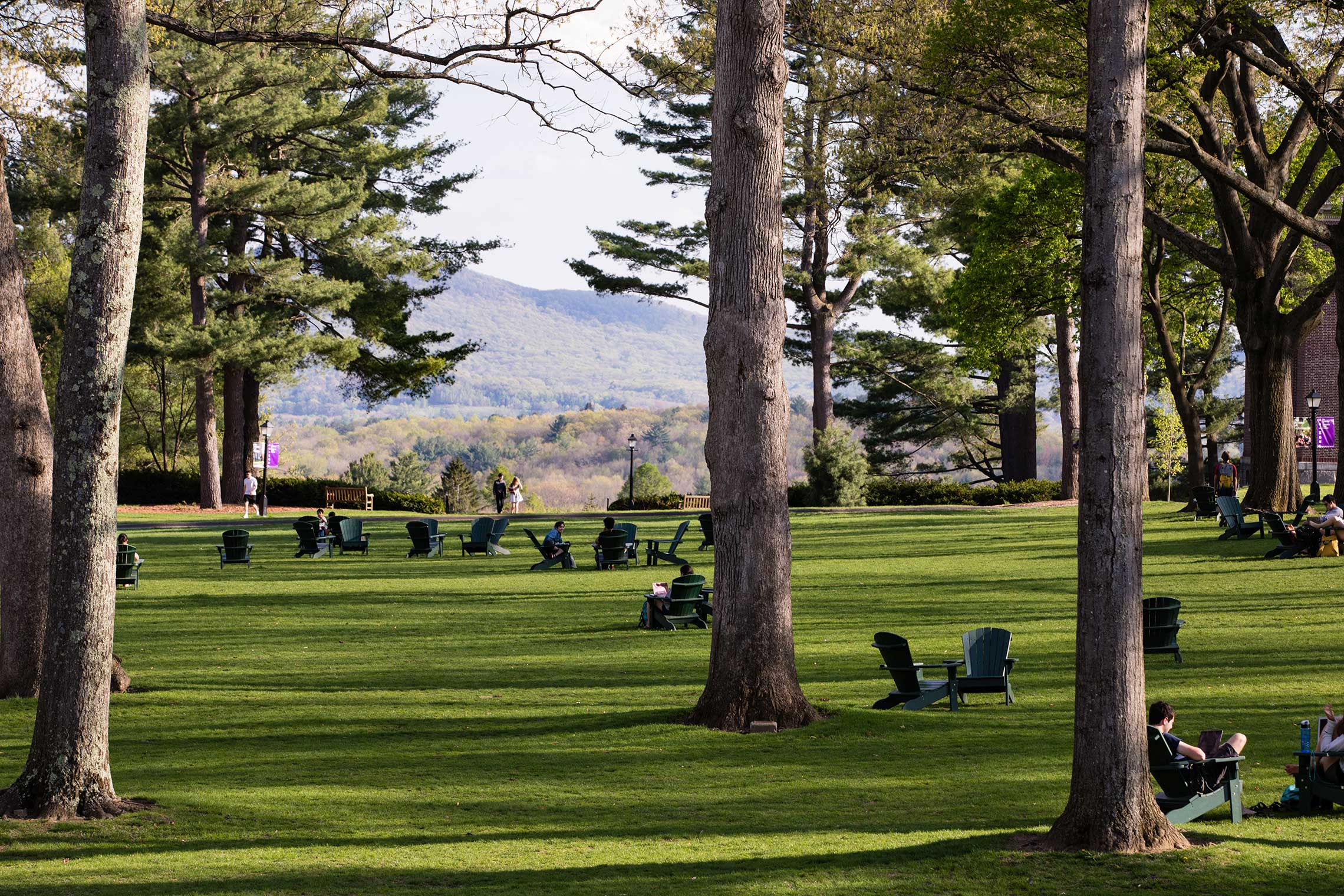 Adriondack chairs on the main quad on a sunny spring day.
