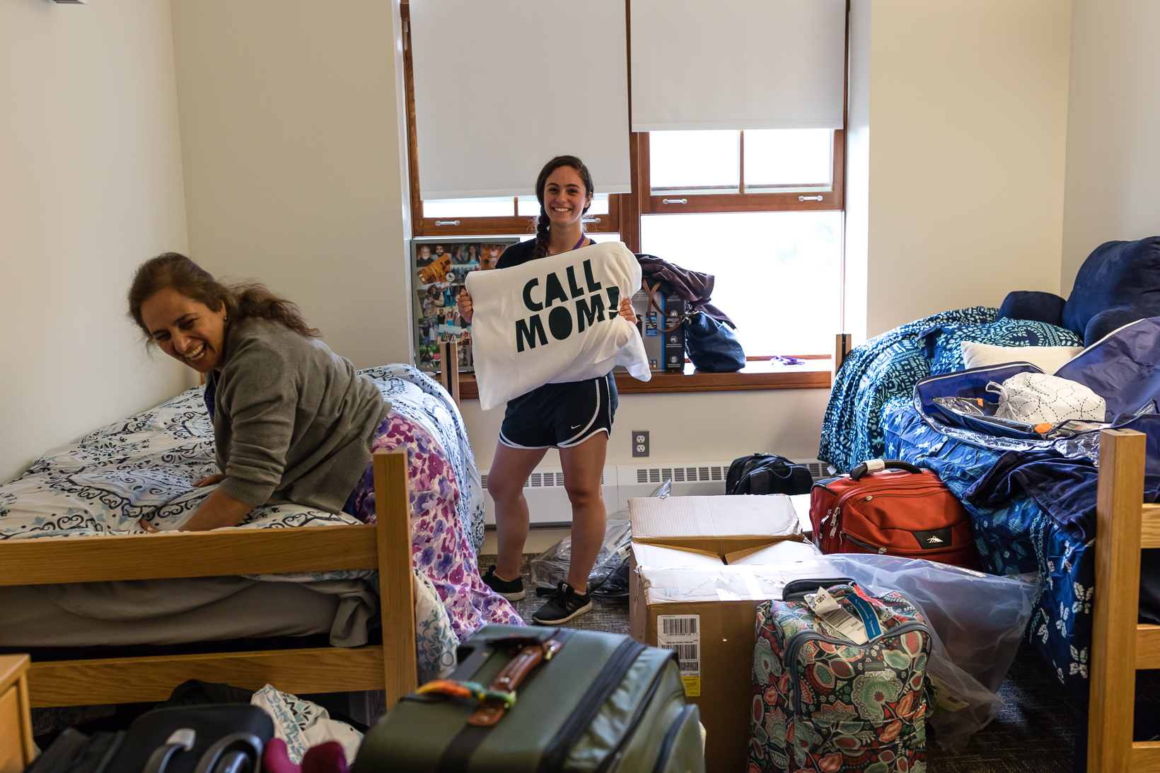 While her mother, Ahang Zafari, makes her bed, Navva Sedigh '21 shares some good advice from her pillowcase.