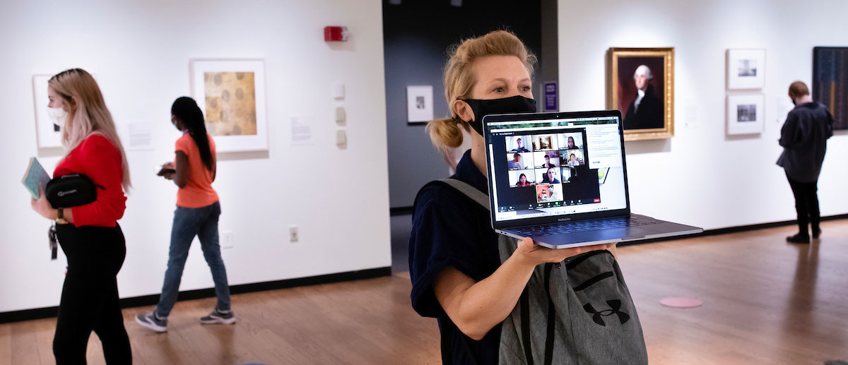 a professor wholes up a laptop for remote students to see inside the mead art museum