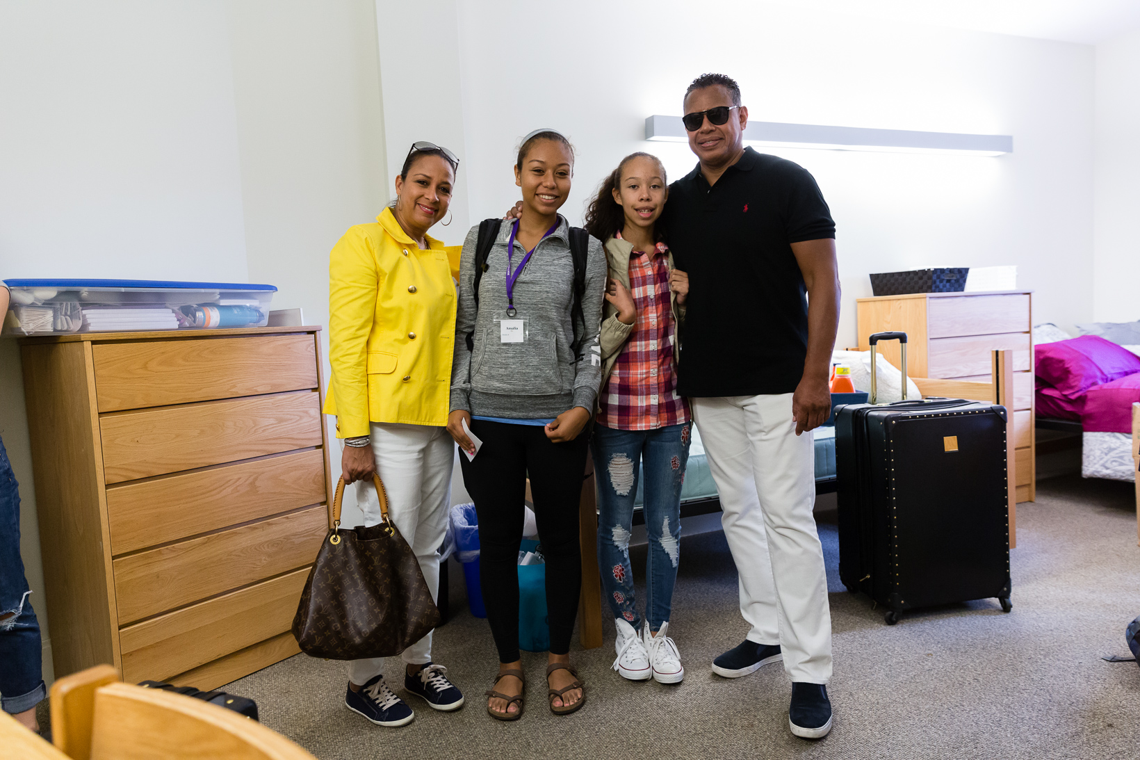 In Stearns Dorm, Amalia Rebekah Roy '21 embarks on life as an Amherst student. She's pictured with her proud family. Photo by Sk