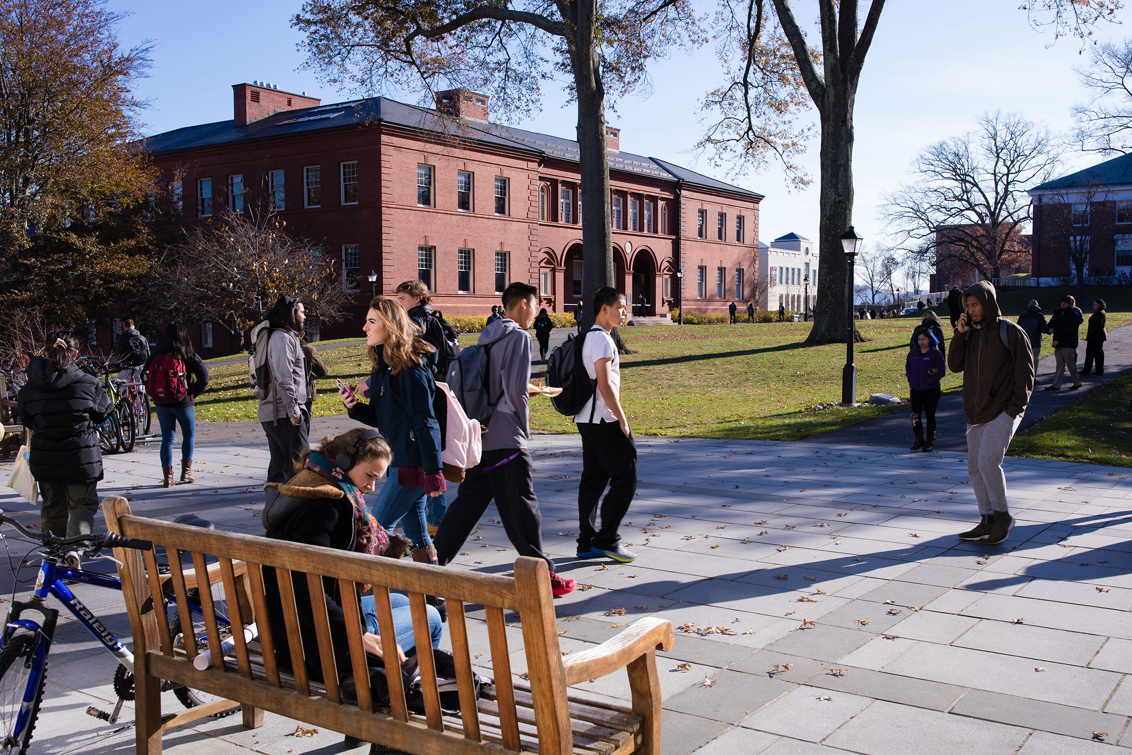Students walking to classes on a sunny day in early fall at Amherst College.