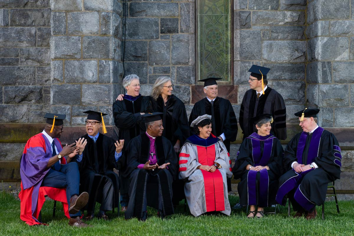 The recipients of honorary degrees at Amherst College gathered in front of Stirn Steeple