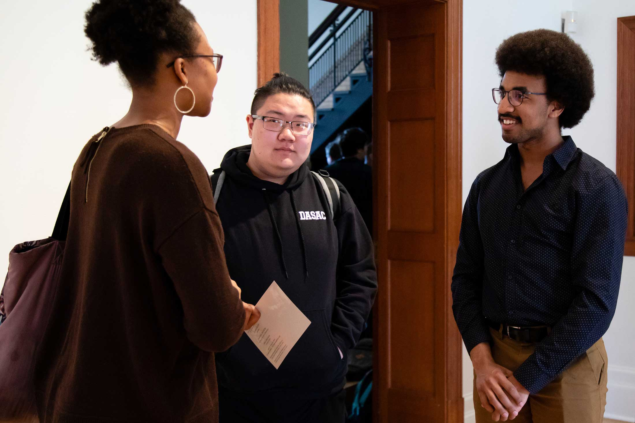 Jonathan Jackson '19 (right) at the reception for 3 graduating artists