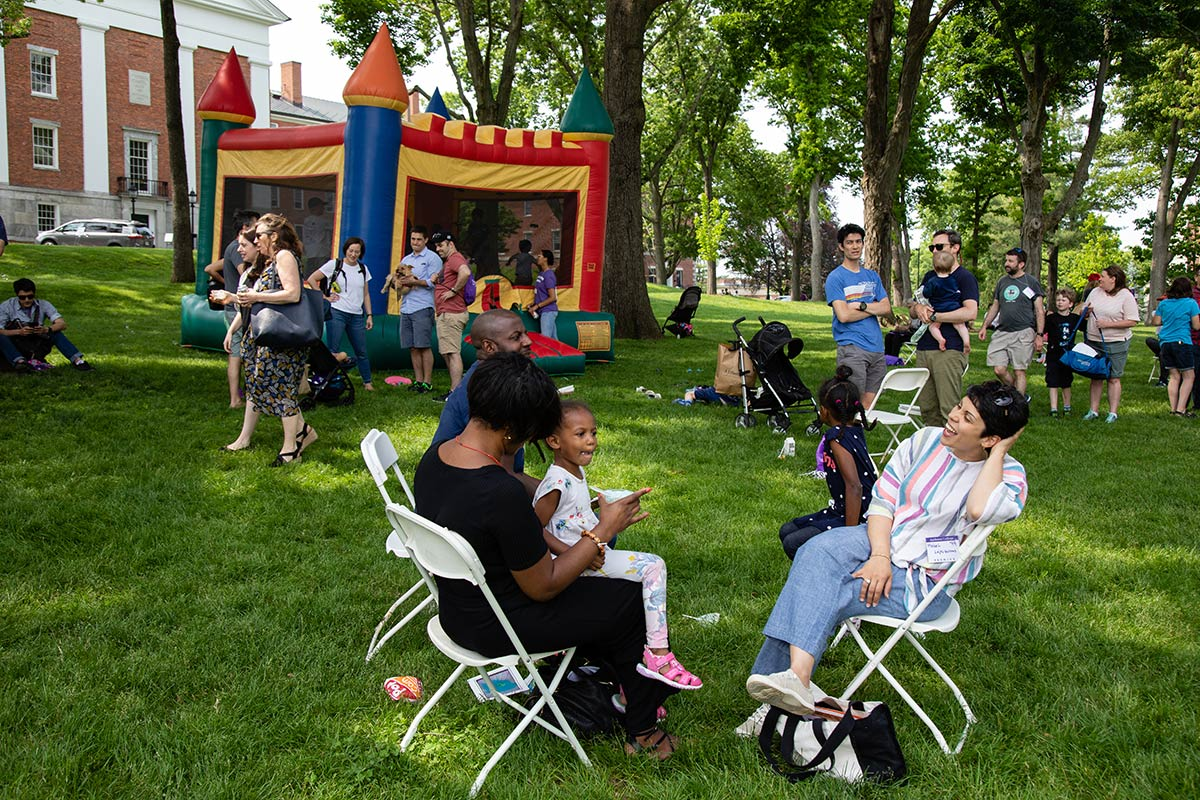 alumni gather outside during reunion carnival