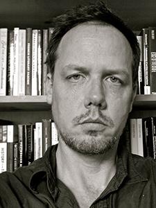 Black-and-white closeup of John Drabinski