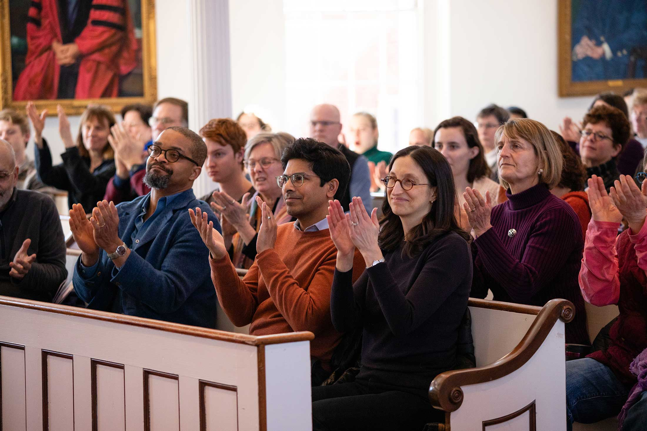 LitFest audience members in Johnson Chapel applauding