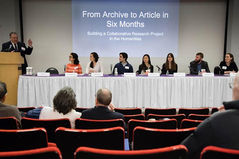 Five students join Ellen Boucher and Dunstan McNutt speaking in Stirn Auditorium.