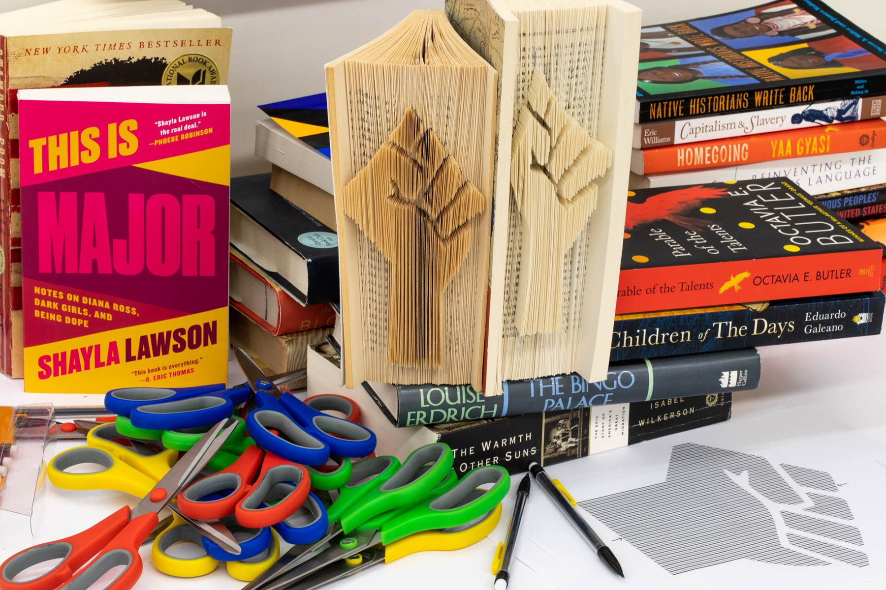 books and supplies for a book sculpting project