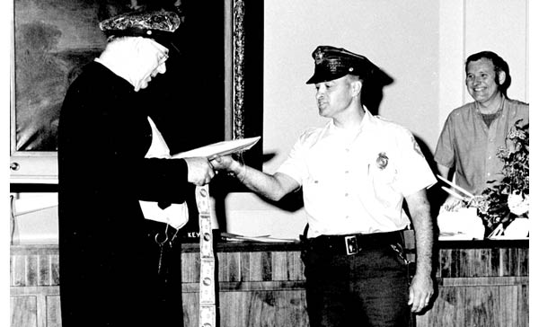 Retired Chief Bill Dion (center) and Officer George landry (left)